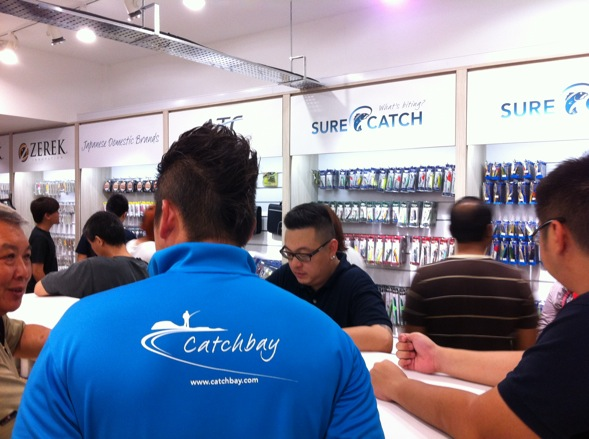 Crew wearing the Catchbay t-shirt speaking with customers.
