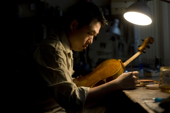 "Master Luthier Tong Ming Xi studied under accomplished violin-makers Horacio Piñeiro and William Salchow. The Straits Times once described Ming Xi as ""the country's modern day musical Geppetto""."